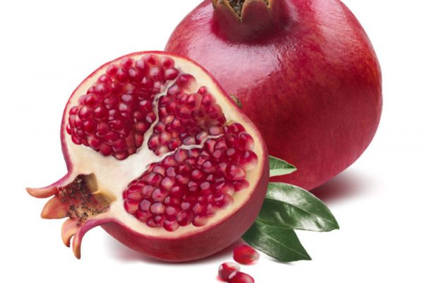 Pomegranate half cut seeds leaves isolated on white background as package design element
